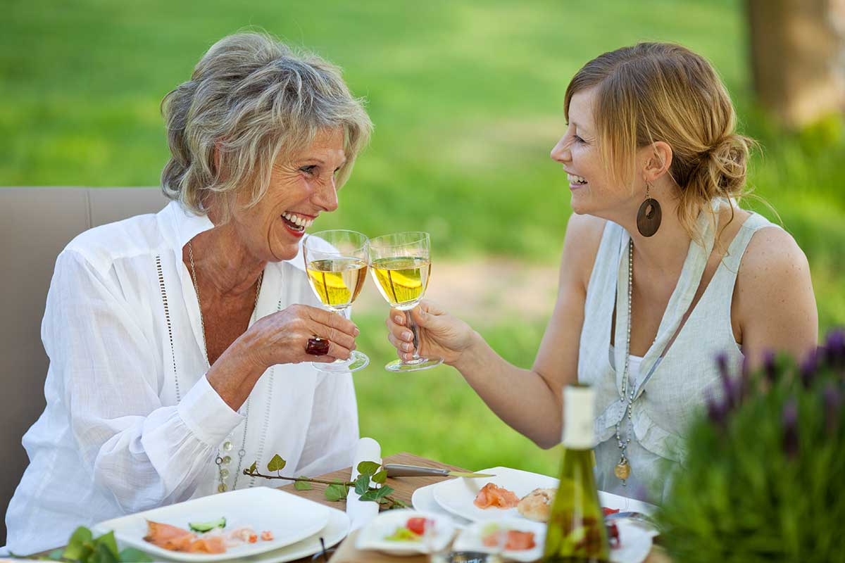 root canal patients enjoying wine after procedure
