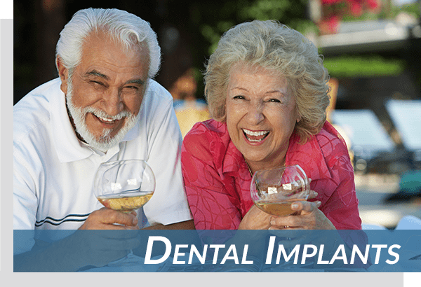 dental implant patients enjoying wine