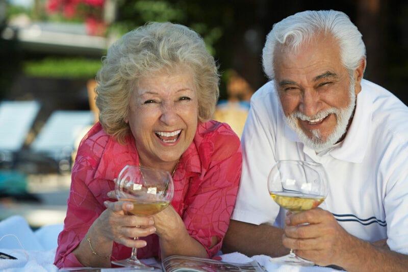 retired dental implant patients enjoying wine